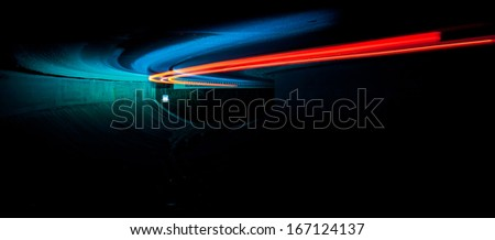 Car light trails in tunnel. Art image . Long exposure photo taken in a tunnel