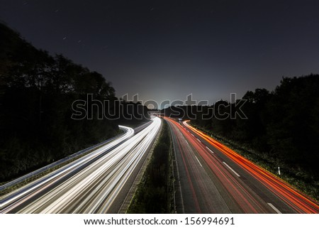 Car light trails on highway at night