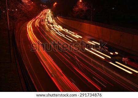 car light trails on the street/car light trails/ light trails on the street at night