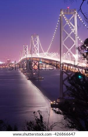Car lights create streaks in this long exposure of the Bay Bridge #426866647