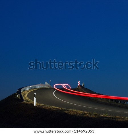 Car lights on a highway overpass - stock photo
