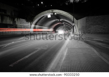 car lights trail in a tunnel in Malaga, Spain