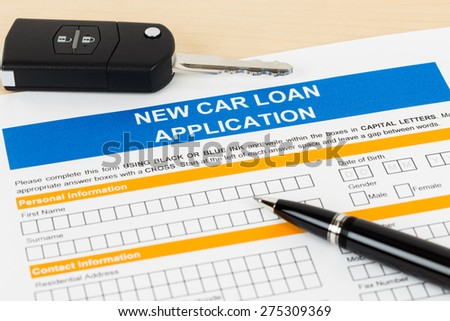 Car loan application with car key and pen