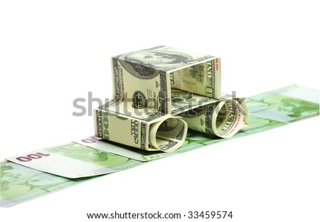 Car made of dollars isolated on white.