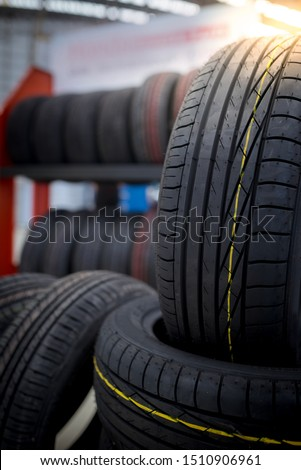 Car maintenance and service center Tire repair and replacement equipment Changing seasonal tires - New tires are changing.