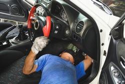 Car mechanic adjusting the clutch pedal height ,hydraulic clutch pedal adjustment.