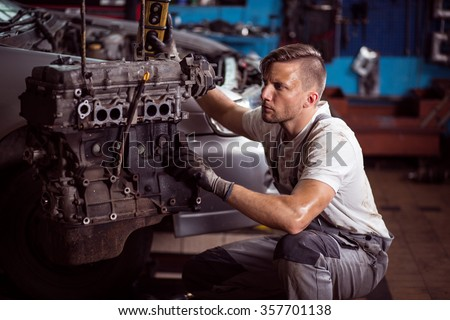 Car mechanic and car engine outside the vehicle