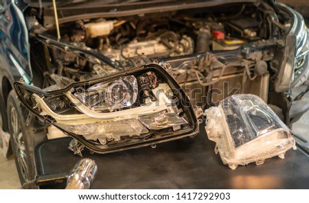 Car mechanic, doing cleaning, The headlight of the car, installation and turning headlight of modern automobile and car projector lens. Vehicle head xenon lamp in details. Concept of auto detailing,  #1417292903