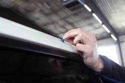 car mechanic repairing dents in car body
