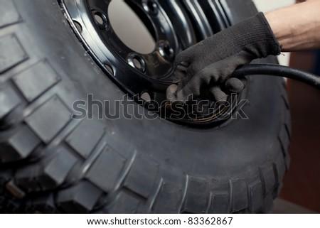 Car mechanic changing brake pads