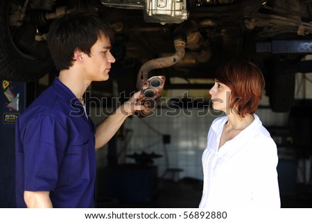 car mechanic talking to costumer at the car  repair  shop