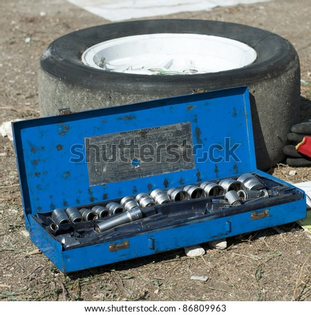 Car mechanic tools and sport tire