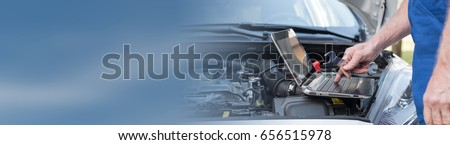 Car mechanic using laptop for checking car engine #656515978