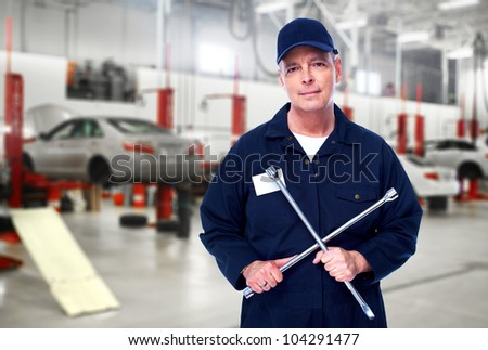 Car mechanic with wrench. Auto repair service.