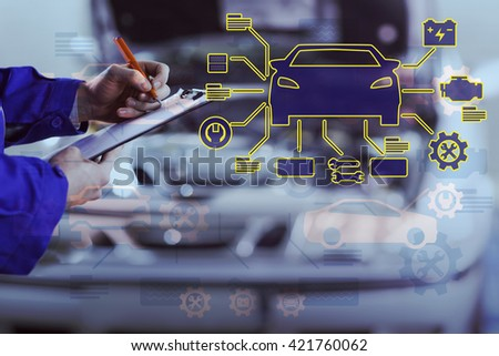 Car mechanics against close up of a man writing on a clipboard