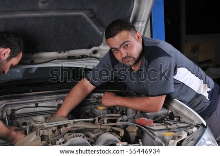 Car mechanics working on a car - a series of MECHANIC related images.