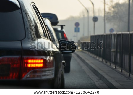 Car mirror in traffic with red tail lights  #1238642278
