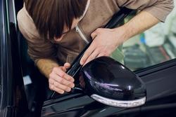 Car mirror man repair,Car accident broken side mirror.
