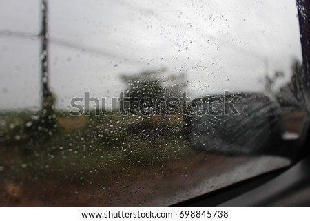 Car mirror on a rainy day in the province. #698845738