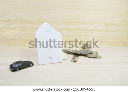 Car models and house models on wooden background. Concept Finance. Financing for home loans.