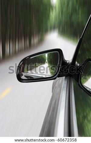 car moving fast into forest with motion blur