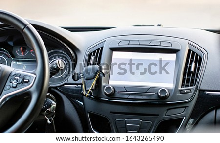 Car navigation system. GPS device in car help driver to find the way. Blank screen with place for text. The concept of artificial intelligence.