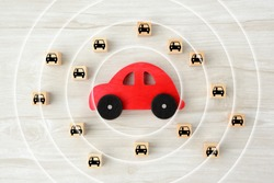 Car object with concentric circles and wooden blocks with car pictogram