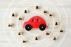 Car object with concentric circles and wooden blocks with human and car pictogram