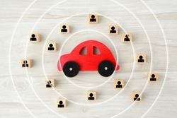 Car object with concentric circles and wooden blocks with human pictogram
