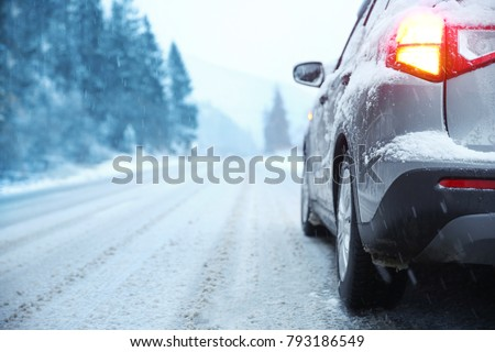 Car on country road in winter day