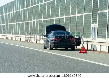 car on the emergency lane, breakdown on the highway. Faulty car  on emergency stopping lane on the roadside. Problem with vehicle Stock photo ©