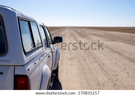 Car on the long road to horizon