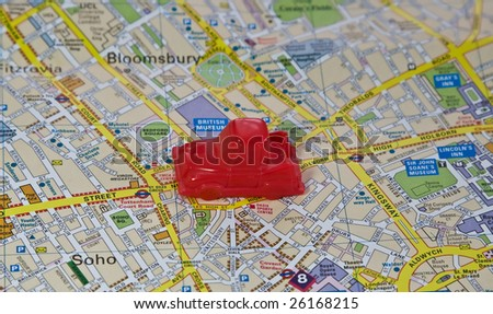 Car on the map of London city - stock photo