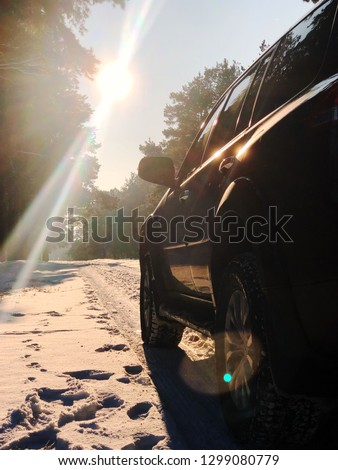 car on winter road in the morning. Vertical picture
