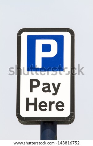 Car park pay sign against a blue sky