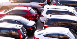 Car parked at concrete parking lot of shopping mall in holiday. Aerial view of car parking area of the mall. Automotive industry. Automobile parking space. Global automobile market concept.
