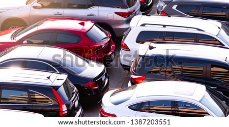 Car parked at concrete parking lot of shopping mall in holiday. Aerial view of car parking area of the mall. Automotive industry. Automobile parking space. Global automobile market concept. Сток-фото ©
