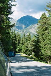 Car parked by the road. Forced stop. Mountain road in the Alps. Brusson, Italy
