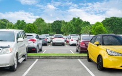Car parked in asphalt parking lot and empty space parking  in nature with trees and mountain background .Outdoor parking lot with fresh ozone and eco friendly green environment concept