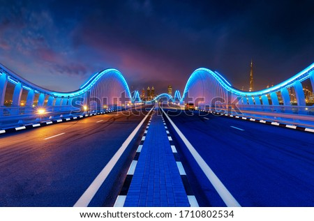 Car Parked on bridge in Dubai Meydan Bridge is one of the most VIP iconic bridges know in DUBAI. With a twisty edge to edge top it looks stunning.