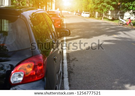 Car parked on road,Car parked on street #1256777521