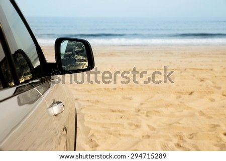 Car parked on the beach. Vacation, summer, adventure, outdoors concept.