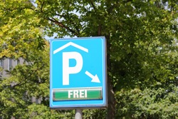Car parking available sign Berlin Germany. Translation for German - Free.