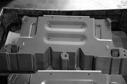 Car parts Produced by Sheet Metal Stamping Tool Die. Black-and-white photo.