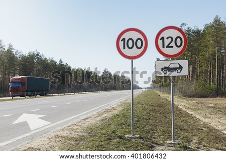 Car passing speed limit sign 100 and 120 #401806432