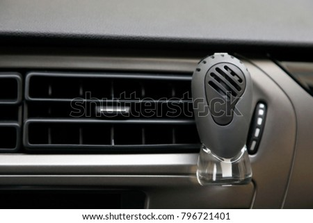 car perfume in front of automobile air conditioning ventilation covers #796721401