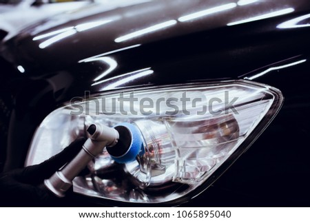 Car polish wax worker hands holding polisher and polish car detailing or valeting concept #1065895040