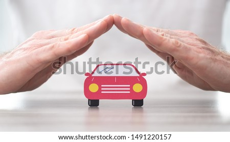 Car protected by hands - Concept of auto insurance #1491220157
