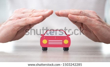 Car protected by hands - Concept of auto insurance #1503242285