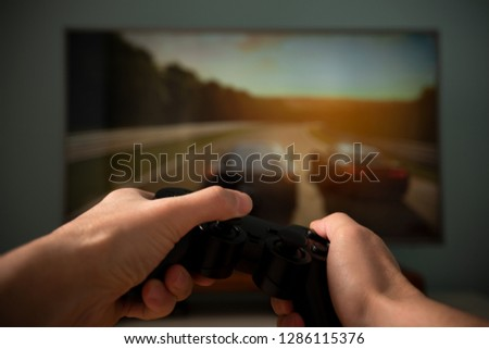Car racing game with game console, game concept #1286115376